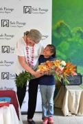 Deb-receives-flowers-from-a-Safe-Passage-student